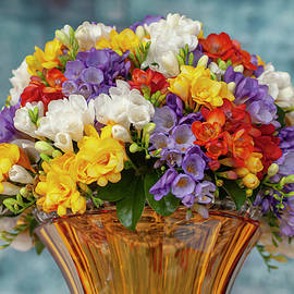 Freesia and Orchids Mixed Bouquet in Vase by Jenny Rainbow