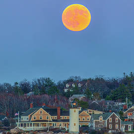 Full Beaver Moon Rising Behind Annisquam Harbor Lighthouse by Juergen Roth