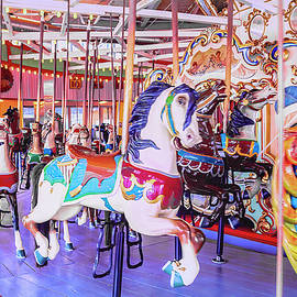 Fun on the Coney Island Carousel  by Kay Brewer