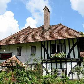 Gardens and English colonial Tudor bungalow cottage now boutique hotel Cameron Highlands Malaysia by Imran Ahmed