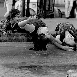 Girls at Jackson Square, New Orleans by Michael Fleischmann