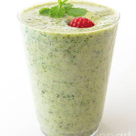 Glass of green detox smoothie. by Hanna Tor