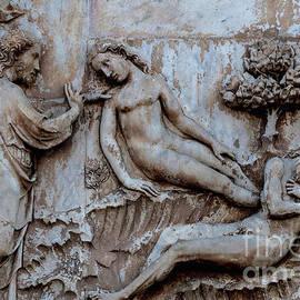 God creates Eve from sleeping Adam, 1300s Lorenzo Maitani sculpture, Duomo, Orvieto, Umbria, Italy by Terence Kerr
