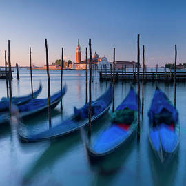 Gondolas and Cathedral of San Giorgio Maggiore, Venice, Italy by Justin Foulkes