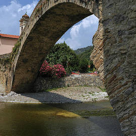 Graceful 15th century single arch bridge painted 1884 by Claude Monet at Dolceacqua, Liguria, Italy by Terence Kerr