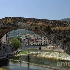 Graceful jewel of lightness 1400s bridge at Dolceacqua, Liguria, Italy, painted by Claude Monet   by Terence Kerr