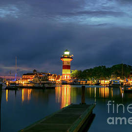 Harbor Town Lighthouse Sunset by Norma Brandsberg