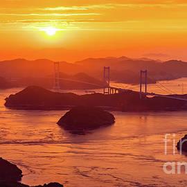 Hazy Sunset on Kurushima Kaikyo Bridge and Kurushima Strait by Lyl Dil Creations