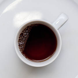 Healthy black tea on a cup by Michalakis Ppalis