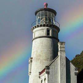Heceta Head Lighthouse Rainbow by Mitch Shindelbower
