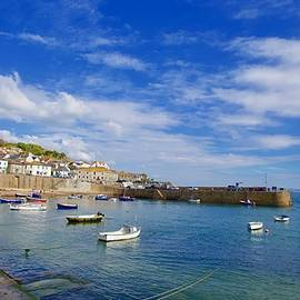 Historic fishing harbour, Mousehole, Cornwall, England by Joe Vella