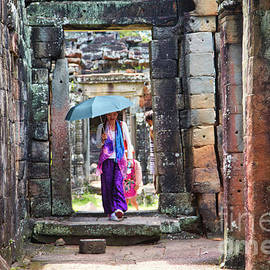 Hot Day Asian Woman Exploring Temples Cambodia Umbrella Color  by Chuck Kuhn