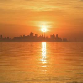 Hot Timing - The Sun Rising Right Behind Toronto CN Tower by Georgia Mizuleva