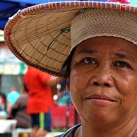 Iban woman with traditional hat by Robert Bociaga