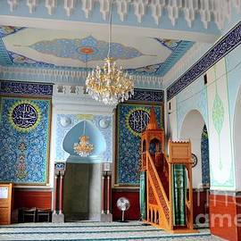 Interior prayer area with blue calligraphy mihrab columns Jumah Central Mosque Tbilisi Georgia by Imran Ahmed
