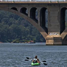 Kayak and bridge graffiti by James Mayo