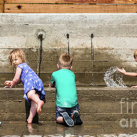 Kids Playing in a Public Fountain by Paul Quinn