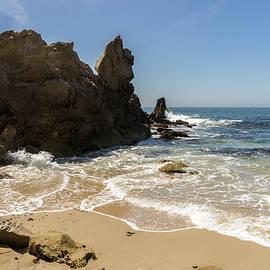 Lacy Foam and Jagged Rocks - Corona Del Mar Beach in Orange County California CA USA by Georgia Mizuleva