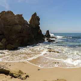 Lacy Seafoam and Jagged Rocks - Corona Del Mar Beach Orange County California by Georgia Mizuleva