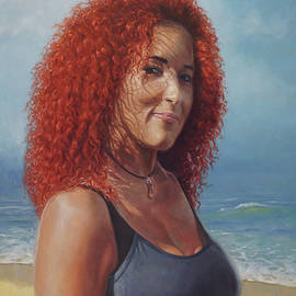Lady with curly red hair in beach setting
