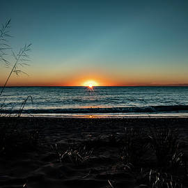 Lake Michigan beach sun rise  by Sven Brogren