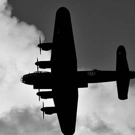 Lancaster Bomber Overhead  by Neil R Finlay