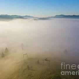 Landscape in the fog by Julia Bernardes