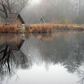 Landscape of a beautiful fishing lake. Winter morning, a mist on the lake, photo series 13. by Akos Horvath