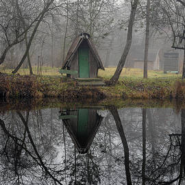 Landscape of a beautiful fishing lake. Winter morning, a mist on the lake, photo series 34. by Akos Horvath