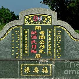 Large Chinese grave and tombstone with golden Mandarin writing at cemetery Ipoh Malaysia by Imran Ahmed