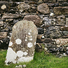 Leaning Tombstone by a Stone Wall - Scotland by Stuart Litoff