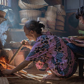 Lighting up the stove for cooking by Anges van der Logt
