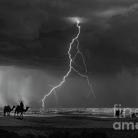 Lightning Essaouria Morocco Camels Black White Awesome  by Chuck Kuhn
