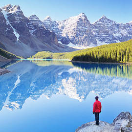 Lone hiker at Moraine Lake, Canadian Rockies by Neale And Judith Clark