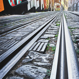 Looking Down The Tram Tracks Lisbon Portugal  by Carol Japp