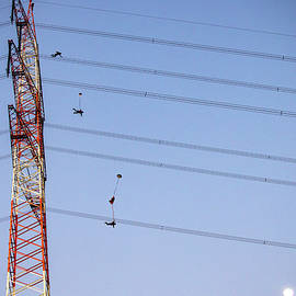 Man BASE jumping from antenna in the evening by Rick Neves
