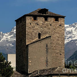 Medieval Tower of the Bailiffs in Aosta at the foot of the Italian Alps by Terence Kerr