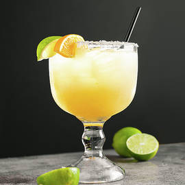 Mexican lime lemon margarita with black backdrop by Zach Matheson