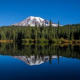 Mirror reflection of Mount Rainier by Lynn Hopwood