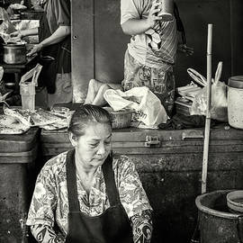 Mother and Child in the Market by Lee Craker