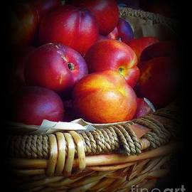 Nectarines in Straw Basket by Miriam Danar