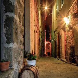 Night street in Italian village by Alexey Stiop