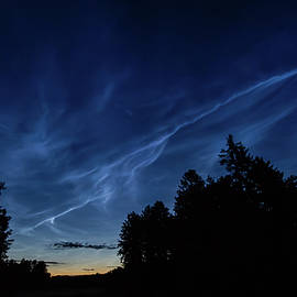 Noctilucent clouds, or night shining clouds by Torbjorn Swenelius