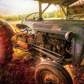 Old Ford Tractor in the Barn at Sunset by Debra and Dave Vanderlaan