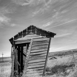 Old outhouse in black and white by Jeff Swan
