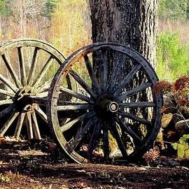 Old Wagon Wheels Retired by Alida M Haslett