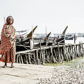 Old Woman with dry fish by Alexey Stiop