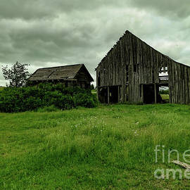 Old wooden barn on a cloudy day by Jeff Swan