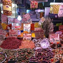 Olives and spices on a  Malaga market stall by Paul Boizot