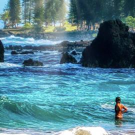 Peaceful Swim at Hamoa Beach by Michele Hancock